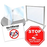Two PPE barriers and warning signs for social distancing and sanitation